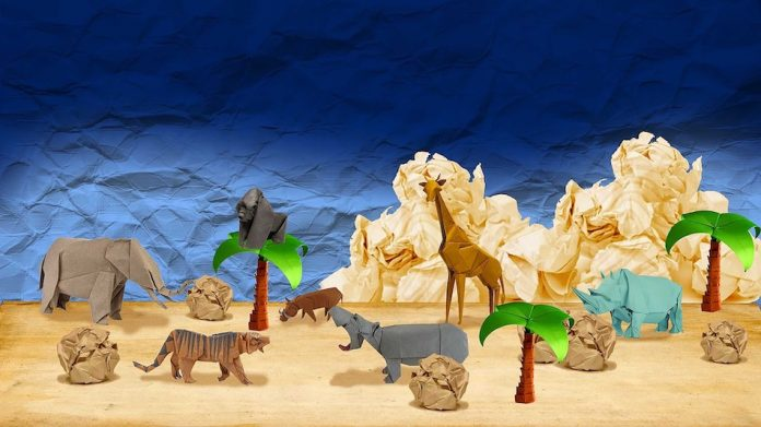 Origami animals from Africa in origami desert setting with origami trees