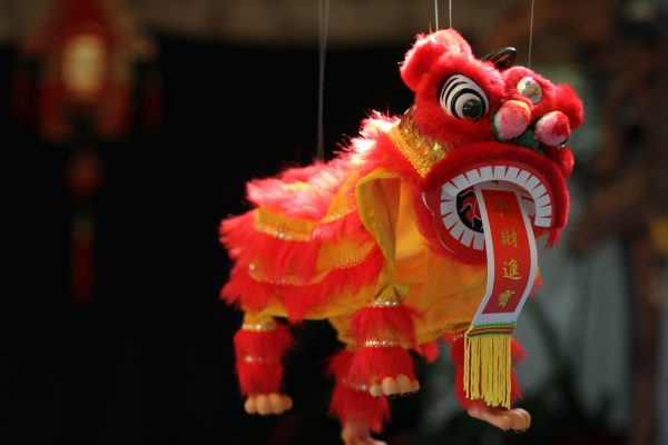 A lion dangling by a string on a market on Chinese New year, also known as the spring festival.