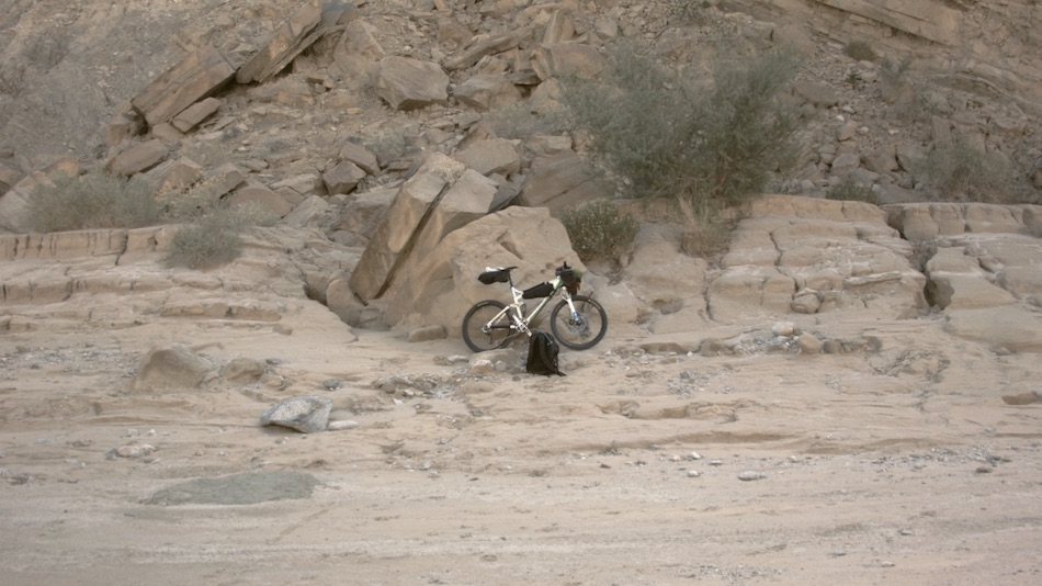 Mountain bike in rocky landscape.