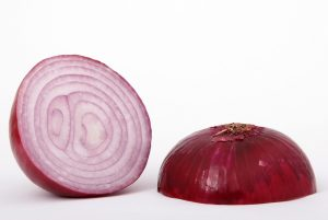 red onion cut in half on white background