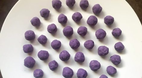 purple ube balls for the recipes stuffing on white plate
