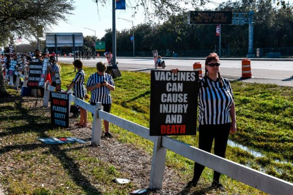 People protest against the covid-19 vaccine outside of the Raymond James Stadium prior to the Super Bowl match between Kansas City Chiefs and Tampa Bay Buccaneers in Tampa, Florida on February 7, 2021