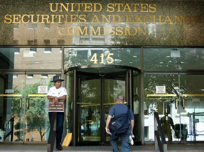 A security guard stands outside of the Security and Exchange Commission offices August 14, 2002 in Washington, DC