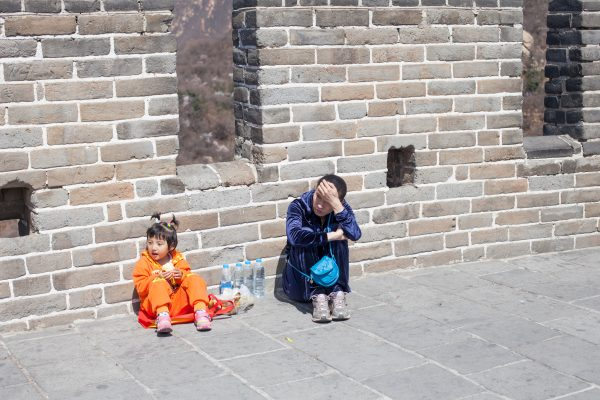 A mother and her daughter rest on the Badaling Great Wall during the Tomb Sweeping Day on April 5, 2014 in Beijing, China. The aging population in mainland China may bring long term troubles to the Chinese economy.