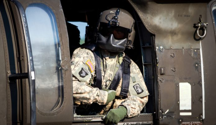Crew chief in a US Army UH-60 Black Hawk helicopter.