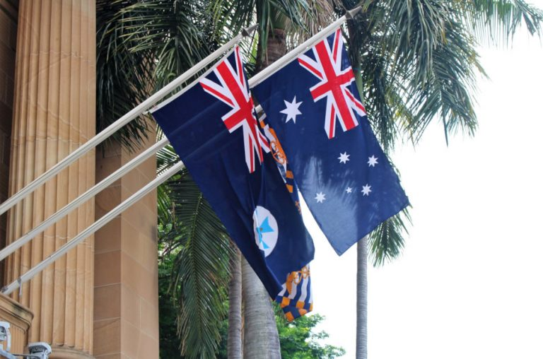 Queensland and Australia flag on a house wall in central Brisbane.