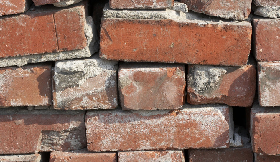 A close up of an old pile of bricks.