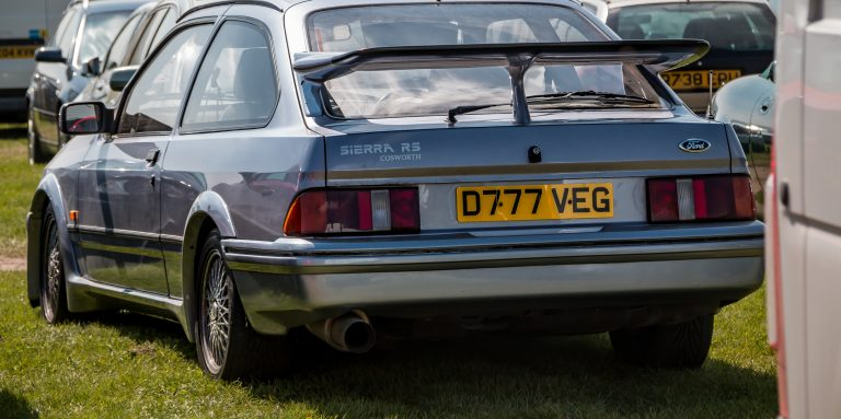 A silver Ford Sierra RS Cosworth.