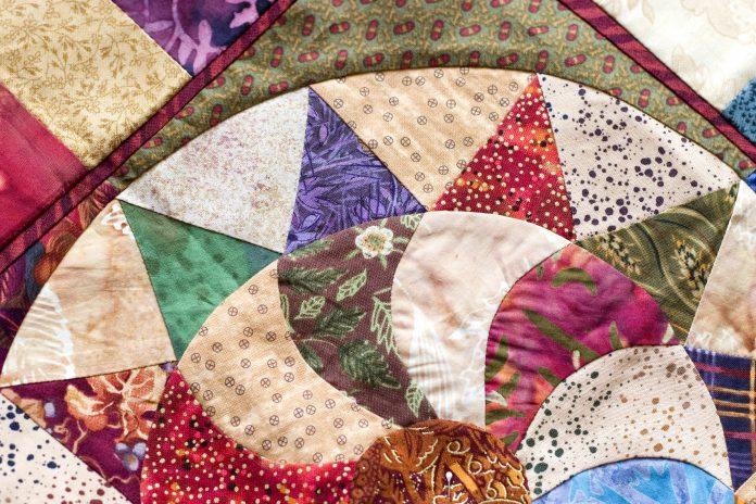 A circular quilt pattern.