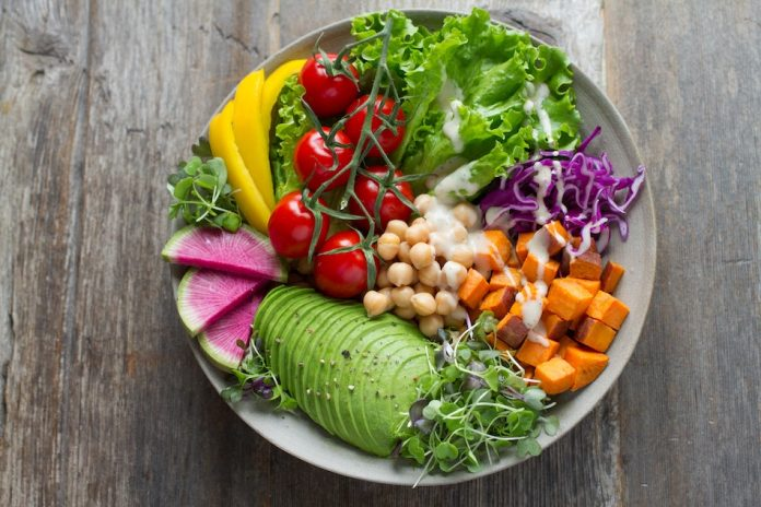 colourful salad and avocado and chickpeas pumpkin tomato lettuce red cabbage yellow peppers