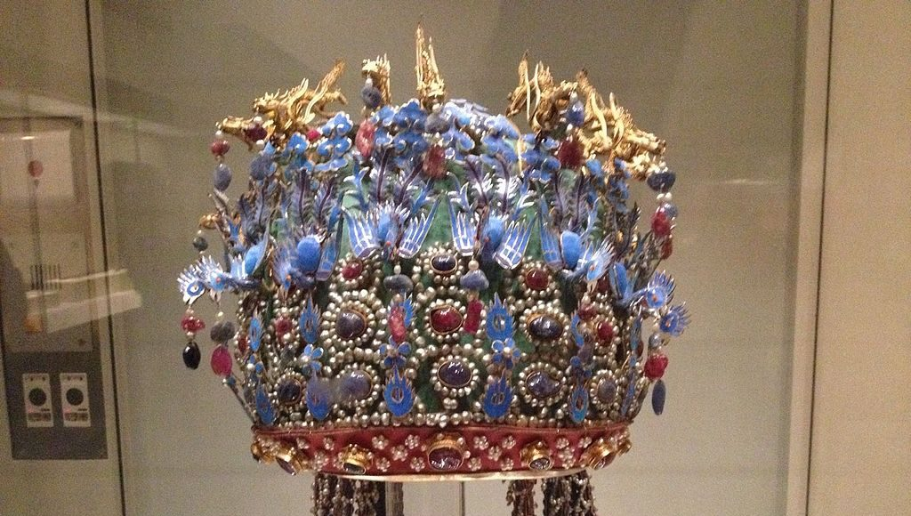Elaborate Chinese headdress made from blue kingfisher feathers, gold, pearls, and other precious gems.