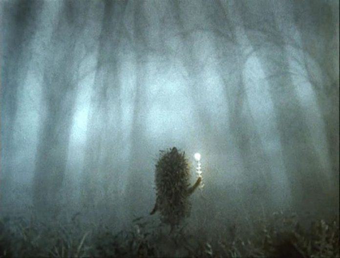 still from the russian animation hedgehog in the fog - hedgehog is in the fog in a forest holding a light