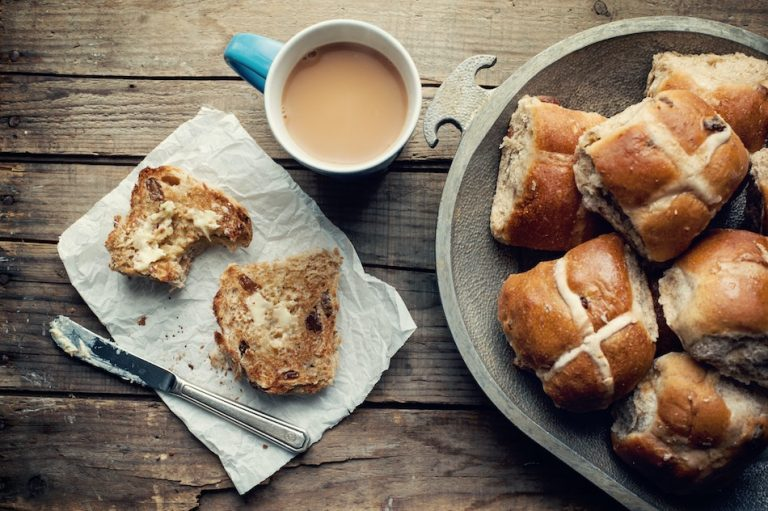 hot cross buns with cup of tea