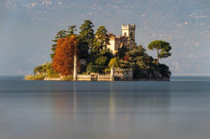 Little island Isola di Loreto on Iseo Lake, Italy.
