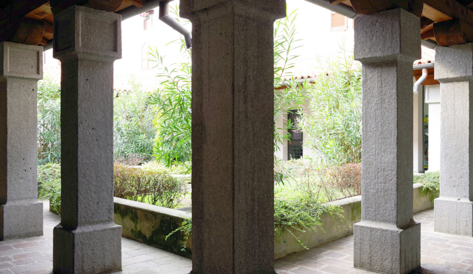 Architectural detail in Iseo, Italy, stone columns surrounding a courtyard.