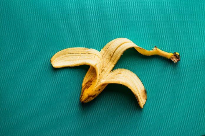 banana peel on aqua color background