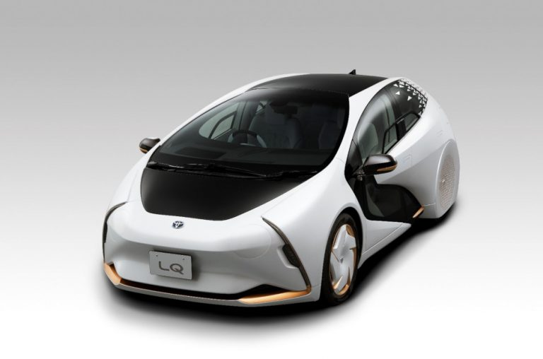 A futuristic looking autonomous vehicle, Toyota's LQ concept car in white with black and gold accents.