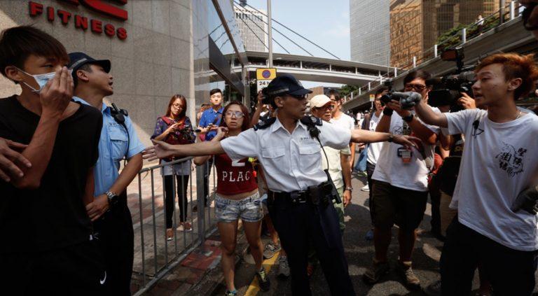 In 2014, men in white tee shirts descended on demonstrators in Mongkok, Hong Kong.