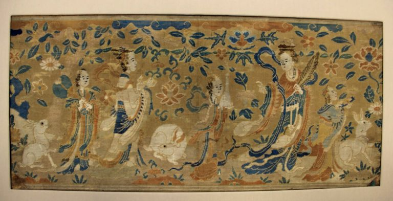 Legend of Houyi and Chang'e. Panel with the Moon Goddess and Attendants. The osmanthus leaf held by the largest figure, at the right, identifies her as the Moon Goddess Chang'e, who inhabits her celestial palace along with a white rabbit.