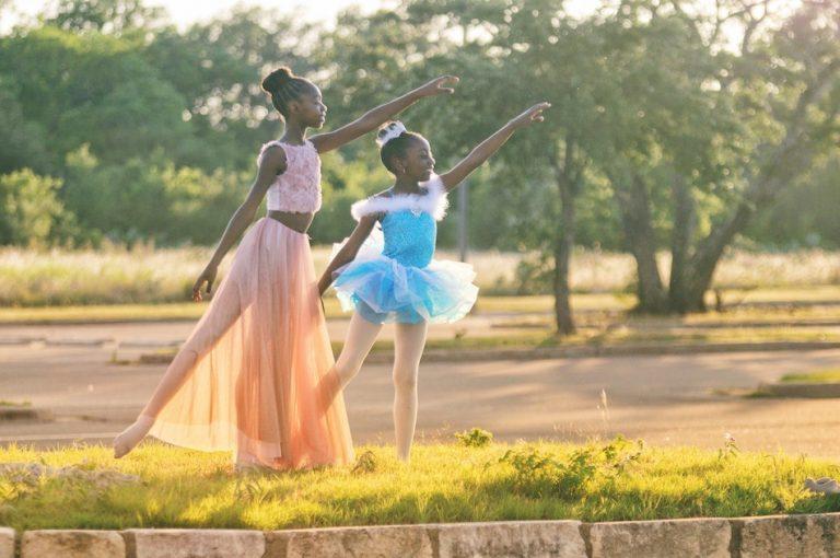 2 girls playing ballerina