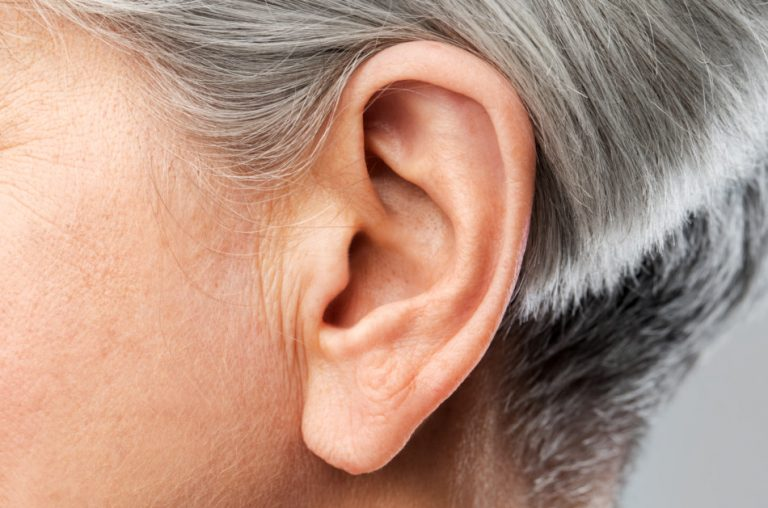 Close up of a senior woman's ear.