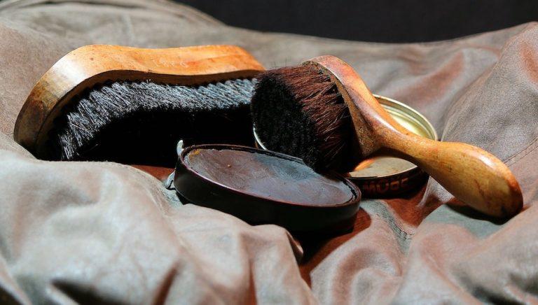 shoe polish open tin with shoe brushes