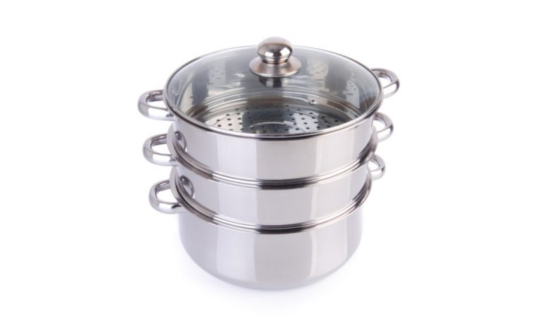 Stainless steel steamer pan with glass lid.