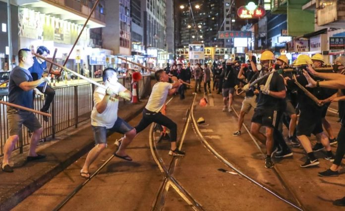Suspected triad members attack pro-democracy protesters in North Point, Hong Kong on August 5, 2019.