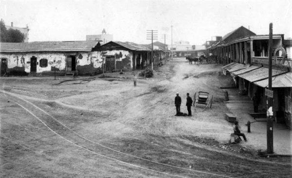Calle de los Negros, Chinatown's center in 1871. Coronel adobe is on left.