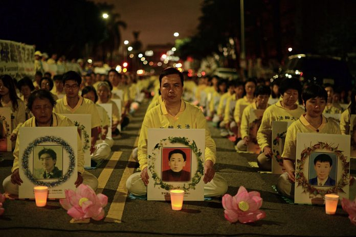 Members of Falun Gong (Falun Dafa) attend a silent protest outside of the Chinese Consulate on October 15, 2015 in Los Angeles, California. The Chinese Communist Party heavily targets the spiritual practice, which it has persecuted severely since July 20, 1999, in its efforts to pressure and silence overseas dissidents.