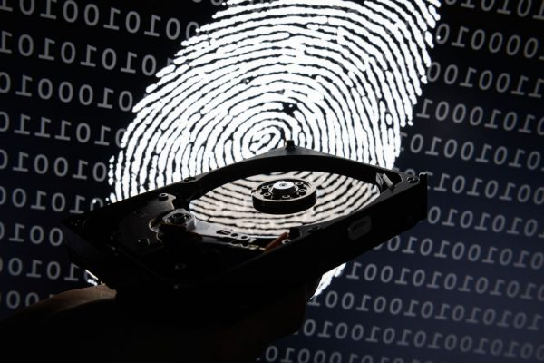 LONDON, ENGLAND - AUGUST 09:  In this photo illustration, a hard drive is seen in the light of a projection of a thumbprint on August 09, 2017 in London, England. With so many areas of modern life requiring identity verification, online security remains a constant concern, especially following the recent spate of global hacks.