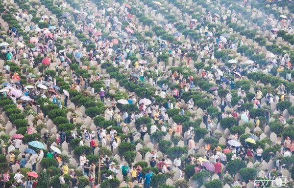 The cemeteries are full of people remembering the dead. Birdseye view photo.