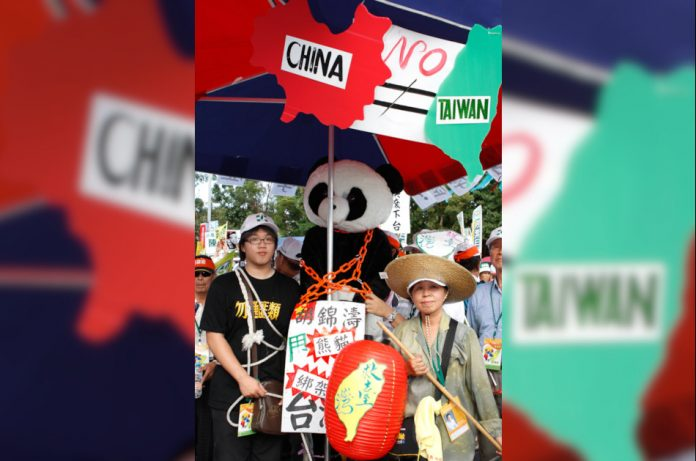 People attending a protest against Taiwan being reunified with mainland China under the rule of the Chinese Communist Party.