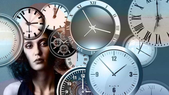 illustration of many clocks in frame with a ladies face
