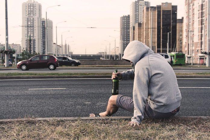 man drinking in the gutter