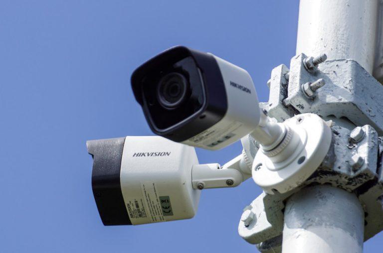 Hikvision surveillance cameras installed on a pole.