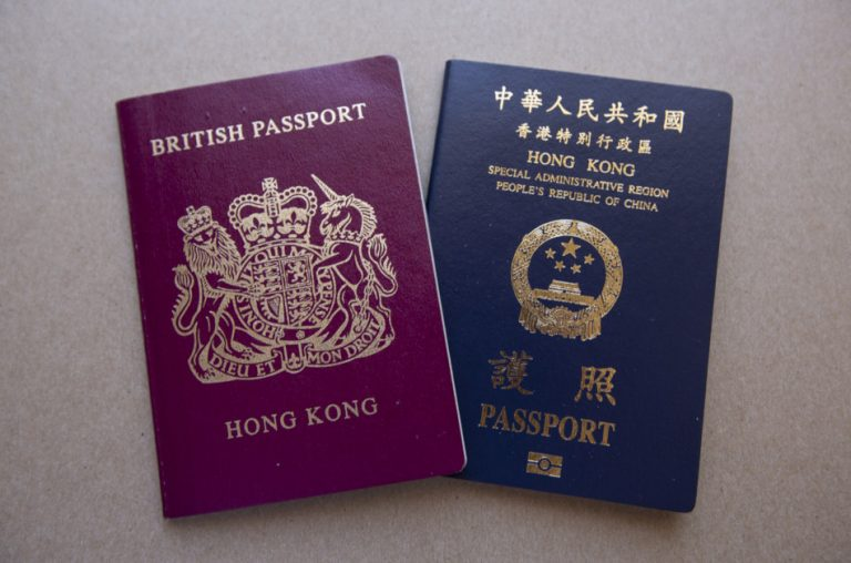 A Hong Kong British National Overseas Passport sits next to a Hong Kong SAR passport.