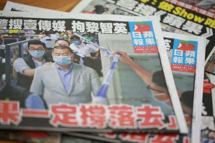 Peaceful and Heroic stand: Jimmy Lai makes headlines in his own newspaper and stands shoulder to shoulder with the people of Hong Kong in their hour of need.