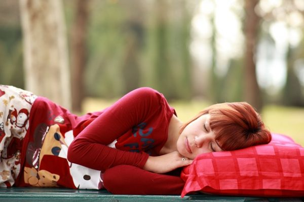 lady in red sleeping on side