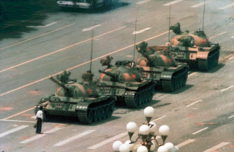Image of the Tank Man, a lone individual standing in front of a line of tanks in Beijing in 1989.