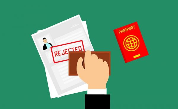 Cartoon image of visa being rejected with a stamp.