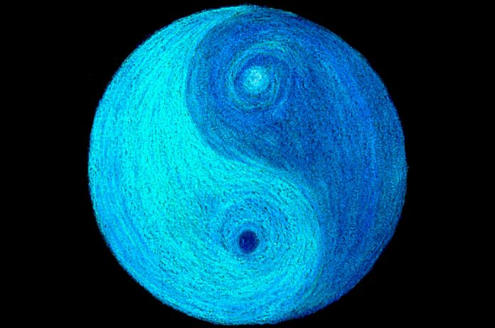 The yin-yang symbol in dark blue and light blue on a black background.