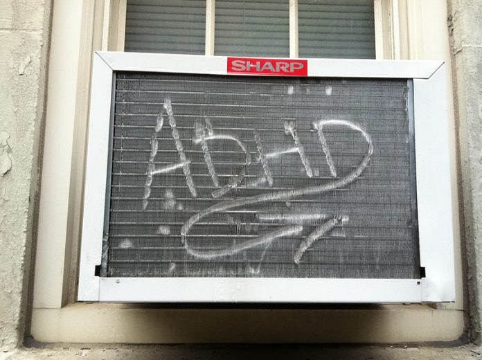 Graffiti on an airconditioner that reads