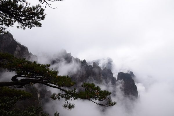 clouds over chinese looking mountains