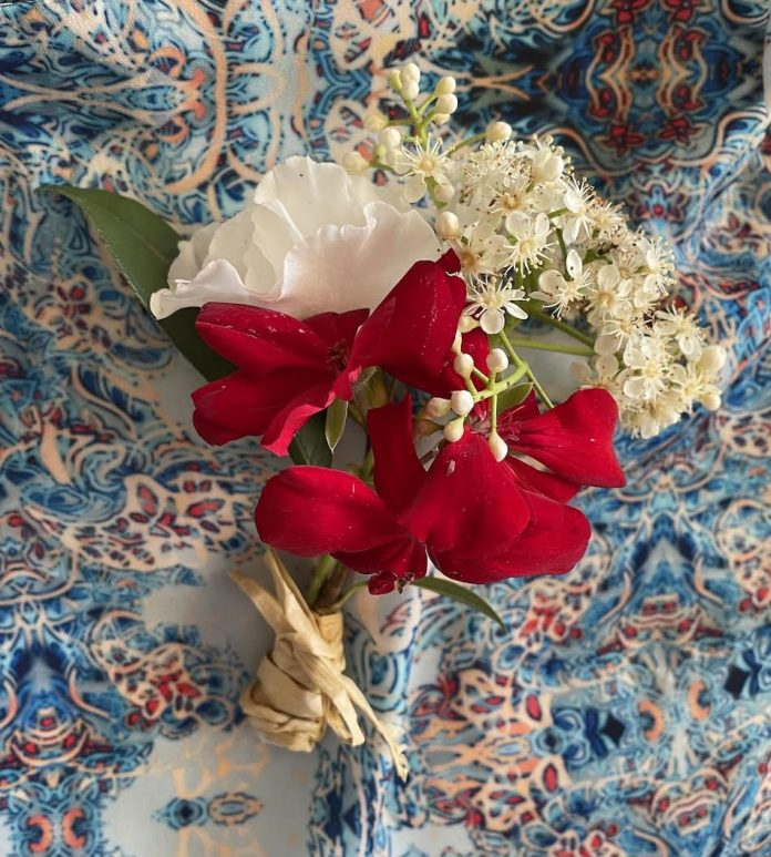 corsage red and white flowers on pattern table cloth