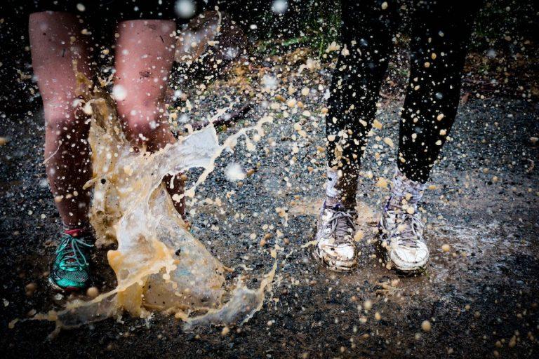 shoes splashing in mud