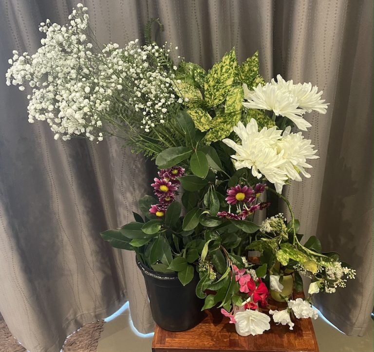 A variety of flowers and leaves picked from my garden along with bought white Chrysanthemums and a bunch of Baby's Breath flowers.