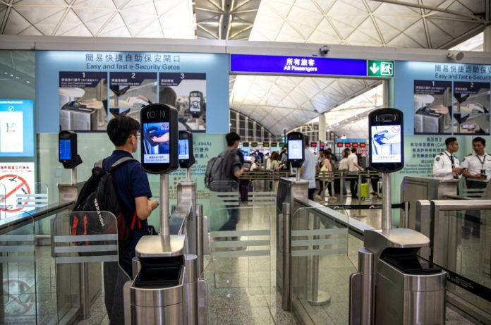 A passenger goes through the departure gates at the Hong Kong international airport.