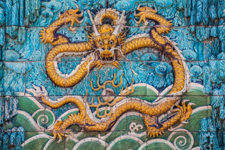 The central yellow dragon from the Nine-Dragon Wall in the Forbidden City in Beijing, China.