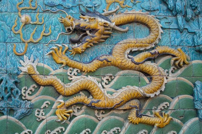 A yellow dragon from the Nine-Dragon Wall in the Forbidden City, Beijing, China.